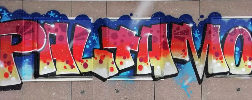 Paltamo-graffiti maalattuna seinään
